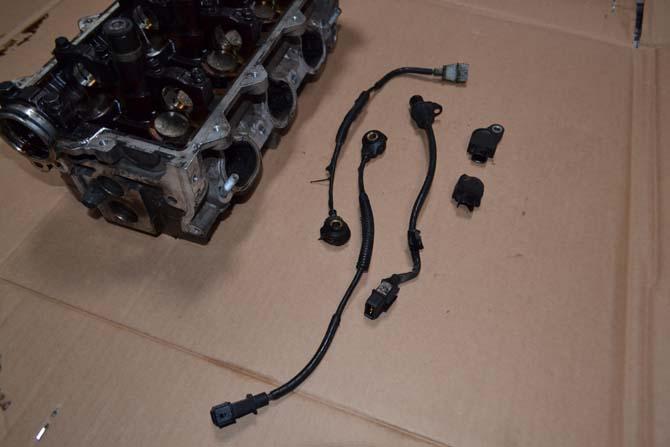 O cabeçote com as bobinas soldadas pelo calor e diversos sensores do motor que derreteram